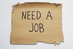 Cardboard that says need a job Royalty Free Stock Photos