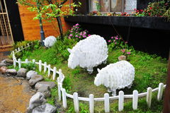Cardboard sheep in a garden Stock Image