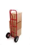 Cardboard shipping box with a tape gun Stock Image