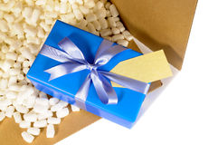 Cardboard shipping delivery box blue gift inside, polystyrene packing pieces, top view Royalty Free Stock Photos