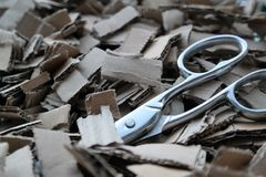 Cardboard shreds with scissors. A pile of cardboard shreds with scissors Stock Photography