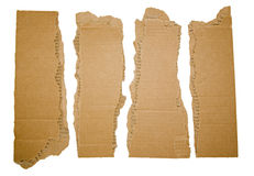 Cardboard strips torn with corners. The ragged paper brown cardboard chunks and remnants create border, corners and edges for adding text and are isolated in Stock Images