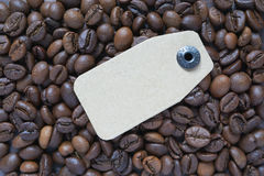 Cardboard tag lay on coffee beans Stock Images