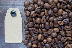 Cardboard tag near coffee beans Stock Images