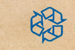 cardboard texture with recycle sign Royalty Free Stock Image