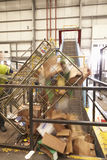 Cardboard tipping into recycling machinery, close-up Stock Photography