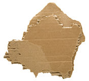 Cardboard torn rough edge. The roughly ripped and jagged edges of the creased cellulose cardboard remnant is used for open space for text with the background stock photo