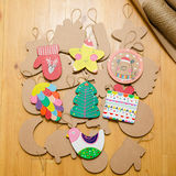 Cardboard toys for the Christmas tree or garland. Royalty Free Stock Photography