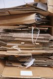 Cardboard trash. Recycle and reuse carton waste. Clean environme. Ntal. Vertical Stock Photo
