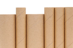 Cardboard tube. Row of cardboard cylinders on a white background stock images