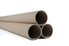Cardboard tubes/rolls. A pile of cardboard tubes used in packaging Royalty Free Stock Images
