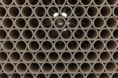 Cardboard tubes on stack. Close up stock image
