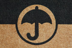 Cardboard umbrella mark Royalty Free Stock Photography