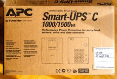 Cardboard unboxing of APC Smart-UPS C 1000VA LCD 230V enterprise. PARIS, FRANCE - MAR 29, 2018: Cardboard unboxing of APC Smart-UPS C 1000VA LCD 230V enterprise Stock Photography