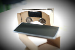 Cardboard Virtual Reality Viewer and Smart Phone Royalty Free Stock Images