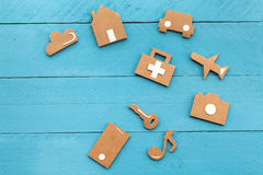 Cardboard web icons on blue background Stock Images