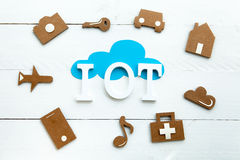 Cardboard web icons,  blue cloud and Iinternet of things acronym Royalty Free Stock Images