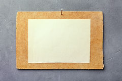 Cardboard with white paper Stock Images