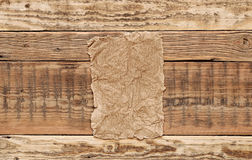 Cardboard on wood background Royalty Free Stock Photo