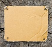 Cardboard On Wooden Background Royalty Free Stock Photo