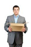Cardboardbox vuoto della stretta felice dell'uomo d'affari Fotografie Stock Libere da Diritti