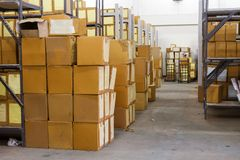 Cardboards box in the warehouse. Cardboards box with products in the warehouse Royalty Free Stock Photography