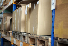 Cardboards with products in the big warehouse. Photo of cardboards with products in the big warehouse stock photography