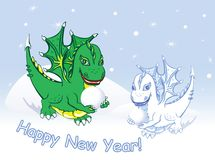 Cardez l'an neuf heureux avec les dragons et la neige Images stock