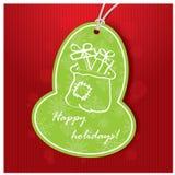 cardez la salutation de Noël Étiquette verte avec Santa Bag Photos libres de droits