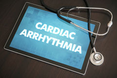 Cardiac arrhythmia (heart disorder) diagnosis medical concept on. Tablet screen with stethoscope stock photo