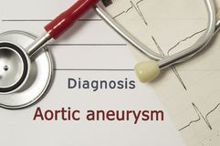 Cardiac diagnosis of Aortic aneurysm. On doctor workplace are red stethoscope, printed on paper ECG line and a pen close-up lying. On medical handbook, which stock photography
