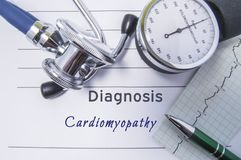 Cardiac diagnosis Cardiomyopathy. Medical form report with written diagnosis of Cardiomyopathy lying on table in doctor cabinet, s. Urrounded by stethoscope stock photography