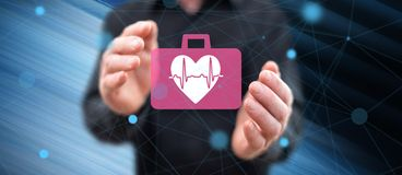 Concept of cardiac emergency. Cardiac emergency concept between hands of a man in background royalty free illustration