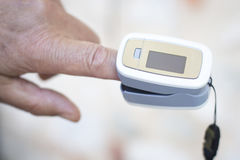 Cardiac finger pulse meter Royalty Free Stock Photography