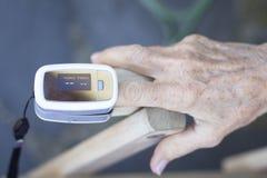 Cardiac finger pulse meter Stock Photos