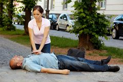 Cardiac massage. First aid for heart attack Royalty Free Stock Images