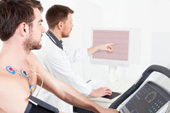 Cardiac stress test ECG Tracings. Doctor shows the patient the ECG recording of the electrical activity of the heart stock photography