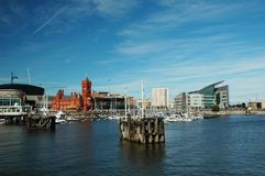 Cardiff bay. With red historical building in very summer nice day with blue sky covered by clouds stock photos