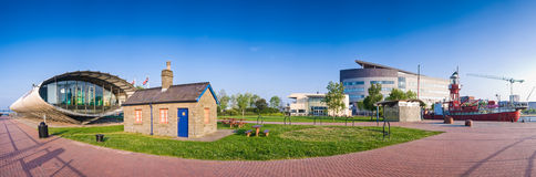 Cardiff Bay. With Tubular Tourist Information Kiosk, new developed apartments and colourful fishing trawler Stock Images