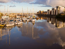 Cardiff Sailing Boat Marina at Sunset. Sailing yachts and luxury properties reflected in the waters of the marina on the River Taff at sunset. Cardiff, Wales stock photos