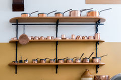 CARDIFF/UK - APRIL 19 : Shelves Full with Copper Saucepans in th Royalty Free Stock Photo