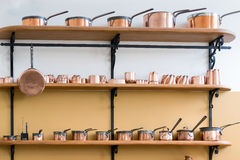 CARDIFF/UK - APRIL 19 : Shelves Full with Copper Saucepans in th Royalty Free Stock Image