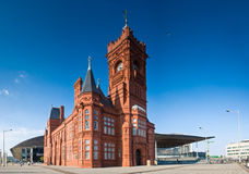 Cardiff views. Pierhead building (1897) familiar landmark of the stunning Cardiff Bay. Millennium Centre and Welsh Assembly building behind royalty free stock photo