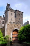Cardiff, Wales: Entrance to Cardiff Castle. The imposing double towers and wooden  entrance doorway to Cardiff Castle in Cardiff, Wales (United Kingdom Stock Photo