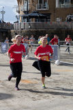 CARDIFF, WALES - MARCH 23 : Unidentified adults running in suppo Royalty Free Stock Photos