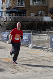 CARDIFF, WALES - MARCH 23 : Unidentified man running in support Royalty Free Stock Photo