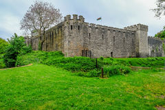 Cardiff, Wales - May 20, 2017:  View of Cardiff Castle from Bute. Park, with Welsh flag flying high Royalty Free Stock Photos