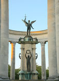 Cardiff war memorial. In Cathays park with white stone pillars and bronze statue of an angel with a sword and a soldier Royalty Free Stock Image