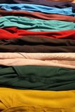 Cardigan. Multicoloured stack of clothes on table Royalty Free Stock Photo