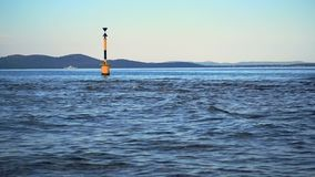 Cardinal buoy, marking hazardous area south of it. Islands in background stock video footage